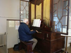 Musical director Philip Carter plays the New Room's Snetzler Organ
